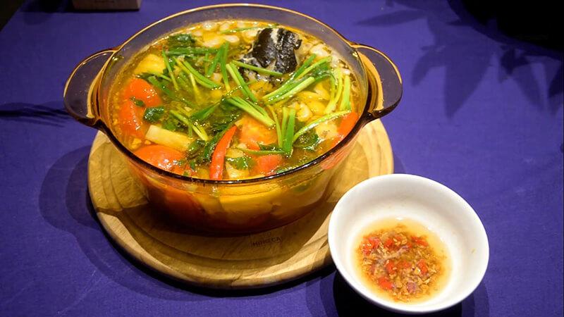 đầu cá nấu dưa chua